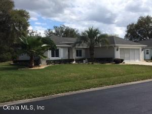 BEAUTIFUL CURB APPEAL WITH MATURE GARDENS AND PALMS