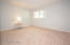 Large Guest Bedroom is located at the front right corner of the home