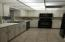 Beautiful white cabinets and black appliances