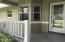 Welcoming front porch under roof