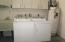 Washer, Dryer, Laundry Tub, Hot Water Heater and storage in garage