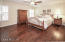 Spacious Master Bedroom Suite is located at the back right corner of the home