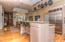 Alternate view of the kitchen/dining area. The first door on your right leads out onto the large wrap-around deck. The second door leads into the living area.
