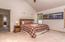 One of two bedrooms upstairs. These bedrooms are large, comfortably-sized with vaulted ceilings.
