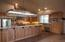 The kitchen has a custom stainless light, breakfast bar, large island.