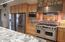 "Counter tops are granite, ""Ecuadorian White"", mural behind the Dacor stove."