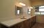 Off the bedroom is the master bath with double sinks, walk in tile shower, and linen closet.