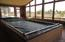 Inside this heated sunroom is a large Endless pool and a hot tub.