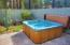 A private hot tub, perfect for relaxing under the stars .