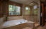 Luxurious soaking tub and glass door shower