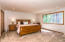 The master suite, which is on the same level as the great room, kitchen, and guest bath.