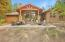 Outdoor living with covered patio and large paver patio for entertaining!