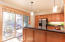Warm tones of wood, granite and stainless steel appliances in the entertainer's kitchen