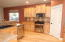 Hardwood hickory flooring, hickory cabs, black SS appliances.