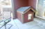 For dog lovers, custom dog house matches this home.