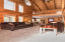 High ceilings with exposed beams and a wall of windows for natural light year around.
