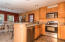 Kitchen & Dining- Solid oak cabinets and stainless steel appliance package.