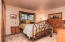 The Master Suite on the main level is comfortably sized.