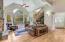 Foyer leads to open floor plan with beautiful oak floors.