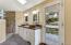 Owners' bathroom, dual vanities, private balcony, huge walk-in shower.