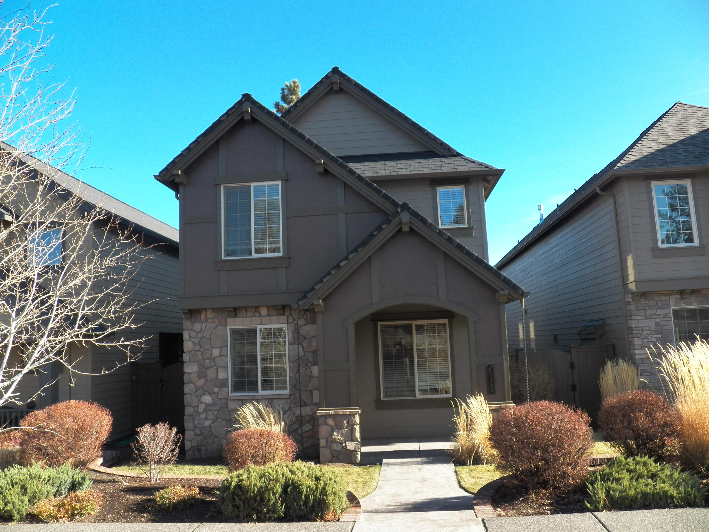**Open House CANCELLED, accepted offer**. Enjoy this well maintained & roomy 3 bedroom, 2.5 bath home located across the street from the private community pool, clubhouse, sports complex and play structure in The Bridges. The great room features a cozy fireplace and is open to the kitchen & dining. The kitchen has nice tile countertops, pantry, gas range and laminate floors. All three bedrooms and 2 full baths fit comfortably upstairs to complete this floor plan. The spacious master suite includes dual sinks & a walk in closet. You'll be comfortable year round w/ a gas forced air furnaces & A/C. On the exterior this home features a dramatic two-story courtyard, adding outdoor living space. Near schools & shopping yet tucked in a private community. Don't miss this wonderful home!