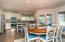 Remodeled kitchen with engineered hardwood floors and granite counter tops.