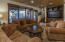 There is also a bonus/family room area on the lower level with a flat screen and a wet bar, The hot tub is just outside.