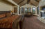 """The large Primary Suite with a fireplace and """"his and her"""" walk-in closets is one of two Suites on the main floor."""