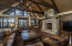 A vaulted Great Room with exposed trusses present a rich, luxurious feel.