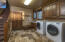 A large mud/utility room off of the garage with stairs to the bonus/media room.