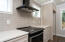 Subway tile on the back wall of kitchen