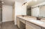Master vanity with double sinks and a seated makeup area