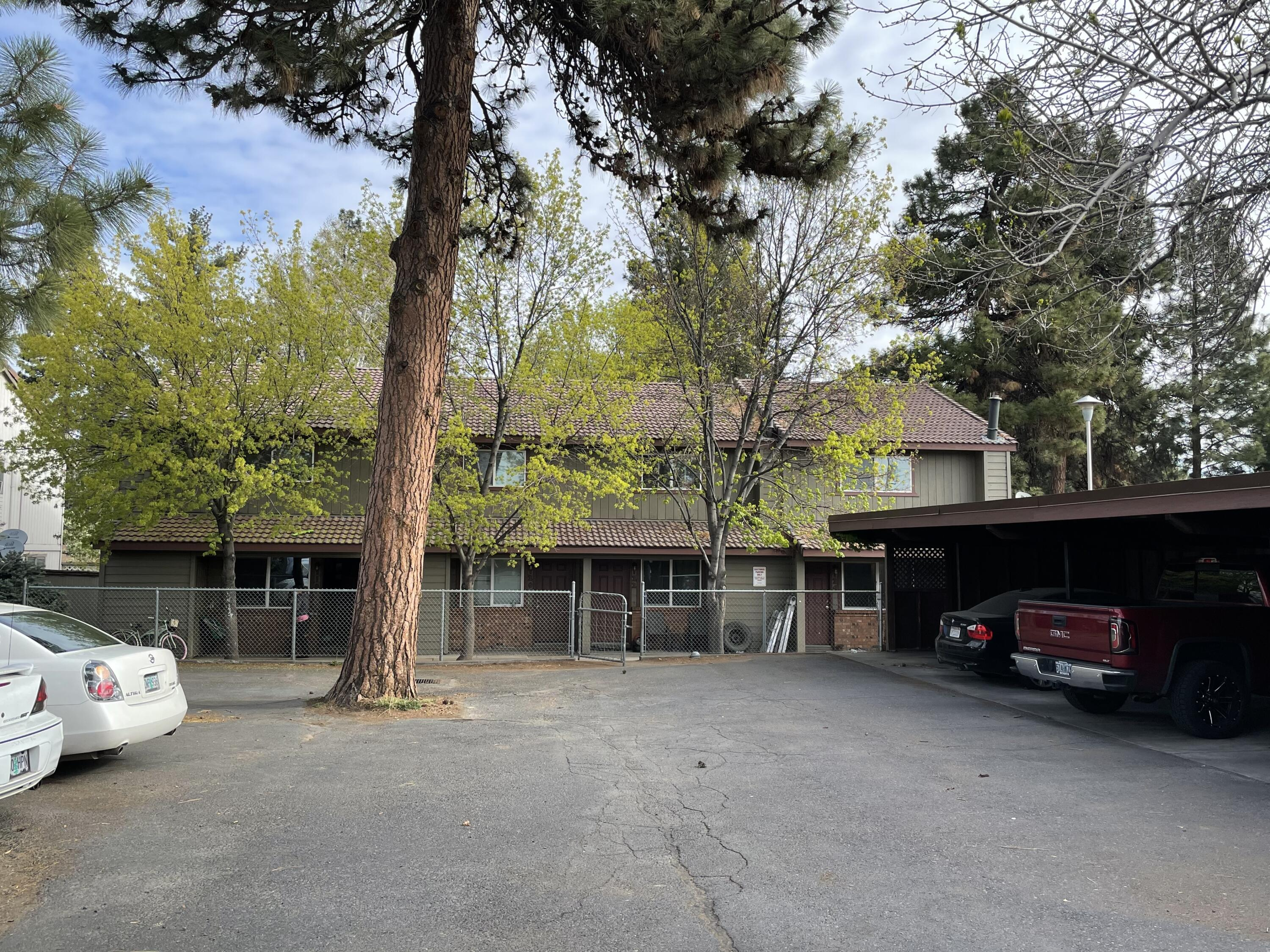 Bend 4-Plex. Two large 3 bedroom/1.5 bath units and two large 2 bedroom/1.5 bath units. Centrally located in Bend with excellent access to all parts of town. Close to the Old Mill and shopping areas. Several long term tenants in place. Rent upsides on all units. Tenants reimburse landlord for W/S/G. Recent upgrades to property over past two years. One unit currently vacant for viewing.  Undergoing some renovation.  Will be marketed at $1,500 per month.