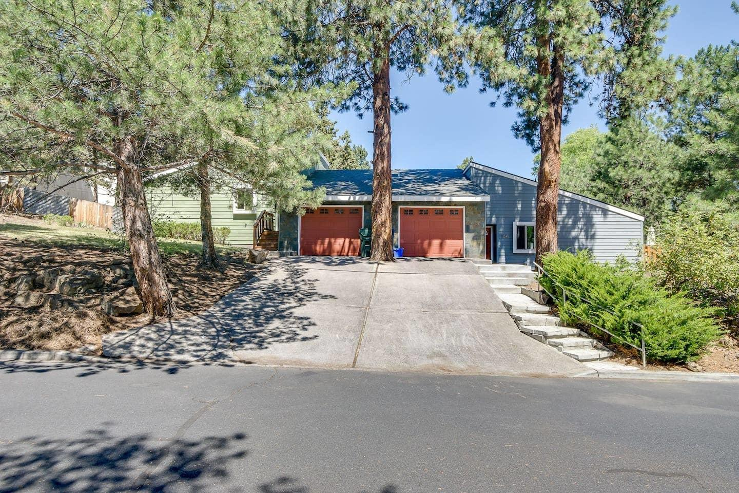 Two very successful Short Term Rentals on one lot! Nicely landscaped Duplex with fenced back yards on a large corner lot. Great opportunity to own a high producing Short term rental in Bend. Buyer to do due diligence regarding all schools and Short Term Rental Permit.