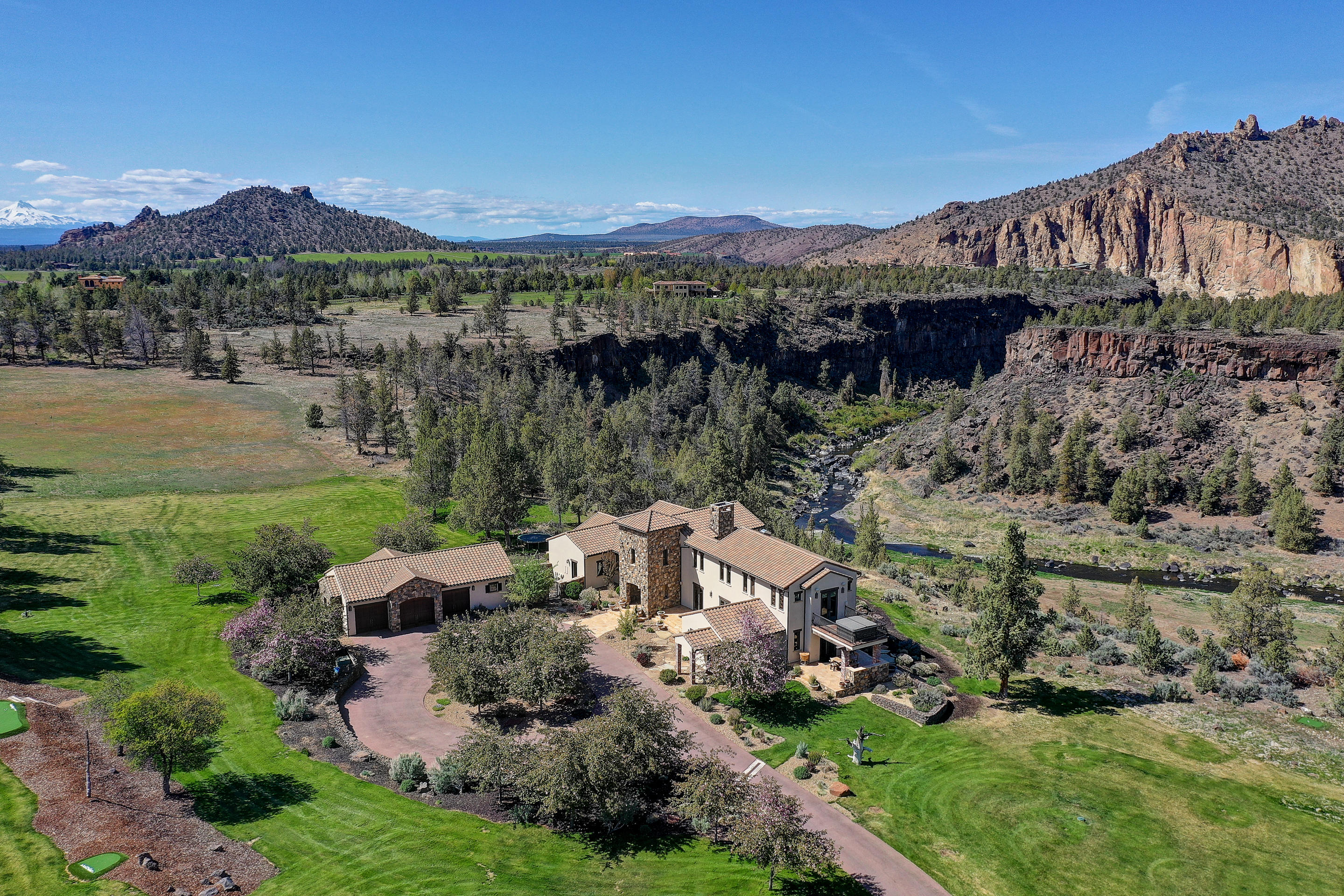 Surround yourself in complete tranquility and luxury on almost 14 acres enveloped by Smith Rock, the Crooked River and the majestic Red Rock Canyon. Theprestigious estate is superior in its phenomenal river views and ultimate privacy. The property has been masterfully refined to become one of the most exquisitehomes in Central Oregon. Boasting a stunning grand entrance and sophisticated finishes with a floorplan that is formal yet creates a comfortable invitingambiance. Other luxury amenities include venetian plaster walls, stone accents ,knotty alder trim, hard wood floors and live edge granite. The towering fireplacemakes a commanding statement from the inside and exterior patio. Multiple family rooms, office, hot tub and putting greens by Back Nine Greens. Your ownpersonal retreat. Also enjoy the outdoor lifestyle the Ranch offers like 1700 acres of meadow, vienyards, river canyon, ponds, hiking/biking trails, clubhouse,pool and tennis courts, equestrian facility and more