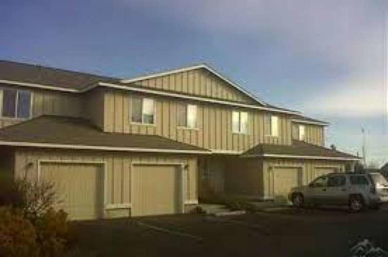 Excellent Income Property. 4-plex. two units are 3 bed, 2 bath. two units are 2 bed, 2 bath. All have an attached 1 car garage. Excellent Neighborhood. Close to schools. 100% rented for 10 years. Current rents are $1,200; $1,300; $1,295, and $950. All units are current being rented for less than fair market value. 3 units are at then end of their leases and rents will be increased this summer to match local rental rate. Please do not disturb the tenants.