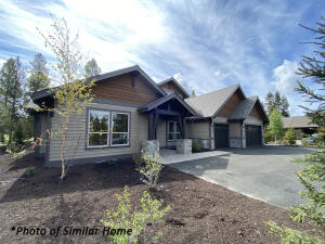 This home is estimated for completion this Summer. Luxury and exquisite craftsmanship plus ample gathering spaces make this the perfect home for large families, reunions, retreats and special get-a-ways. Photo of Similar Home - Floor plan of Lot 15 is a mirror image.