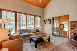 Vaulted wood ceilings in the Great Room overlooking the largest common area in Sunriver. Home has been professionally staged. The furniture/decor package is available for purchase outside of the sale.