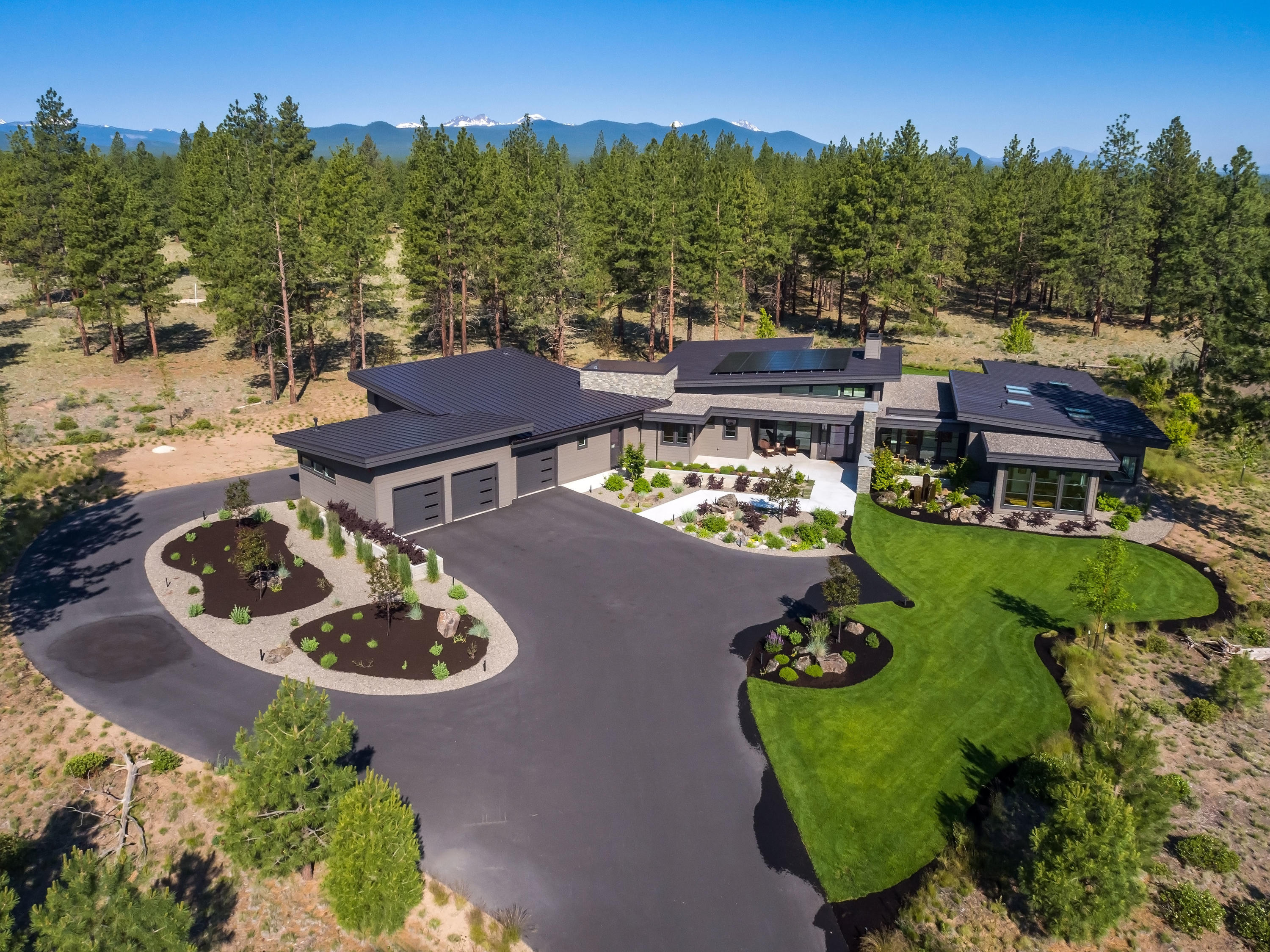 Rare opportunity to live in the exclusive Tree Farm community that offers just fifty diverse two-acre homesites on 400 acres of forest preserve. Bordered by Shevlin Park and U.S. Forest Service land, you are quite literally at the doorstep of Mother Nature's playground. Enjoy uncompromising craftsmanship and finishes throughout this luxurious single-level contemporary masterpiece: matte quartz countertops, white oak floors, custom doors and built-in cabinets; lighted bathroom mirrors; 4 car heated garage including a separate RV parking area (2,291 SF of garage space); smart home features, solar power and so much more. Soak up the abundant sunshine in your open concept great room by the custom Heterofocus 1400 polished steel, wood fireplace while fresh mountain air flows in through the oversized sliding doors that seamlessly integrate the indoor and outdoor living areas. After a long day of work or play, unwind in the private, tranquil backyard in the Hot Springs salt water hot tub.