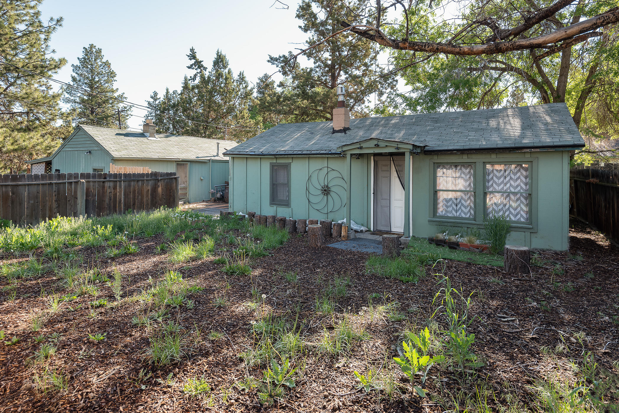 Great investment opportunity in SE Bend. Two separate structures, on two separatetax lots, that can be sold together or separately. Located in the Opportunity Zoneand zoned RM, these two properties have tons of potential. One unit features 480sq ft with 1 bedroom, 1 bathroom, and a storage shed, while the other features 600sq ft, 1 bedroom, 1 bathroom, and a storage shed. Properties are being sold as is.Buyer to do all due diligence regarding future development.