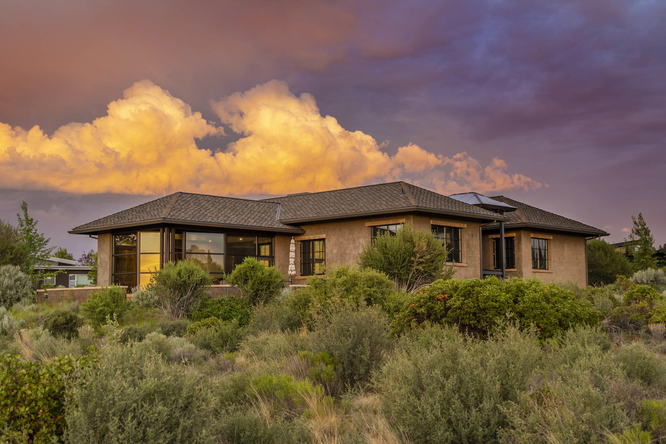 Artfully designed to maximize 180 degree mountain views, set against the majestic backdrop of Shevlin Park and theDeschutes National Forest beyond, this Rosewood home is both unique and exceptional. Here, a rounded scheer wall,enclosed courtyard, and west-facing glass-enclosed dining room evoke a European flair and a main level lifestyle. In the dining room you will find a wall of windows overlooking all the cascade mountains with an additional raised seating nook great for morning sunrises. This open floor plan is great for entertaining both on the main floor and downstairs with a daylight basement setting, both floors include wet bars, extensive storage and wired surround sound for all occasions. This exquisite home offers seamless granite countertops throughout, pecan wood flooring, vertical grain fir doors,heated flooring, 3 heated zones for all season comfort, an additional office & flex space, all surrounding a beautiful courtyard with fountain.