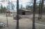 Separate gated entrance to the barn, with 4 run-in stalls.
