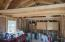 Tack room by barn on 1.70 Acre lot. See the storage above with 4 ft clearing for easy access on either side of upper storage. Gabled, covered front deck. Cute and spacious for your hobbies!