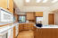Beautiful cabinets with a cohesive horizontal grain throughout the entire home
