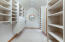 Walk in closet with extra storage in the eves