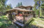 This rear deck has two tiers. One is perfectly set-up for dining. The other, for relaxing...