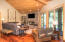 The Great Room has vaulted ceilings with rich, warm wood accents.