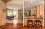 The living area flows directly into the the kitchen/dining areas.