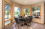 There is a breakfast nook that catches lots of morning sun. There is also a more formal dining area.