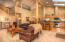 Great room design with huge vaulted ceiling, natural white oak hardwood flooring and recently cleaned carpet.